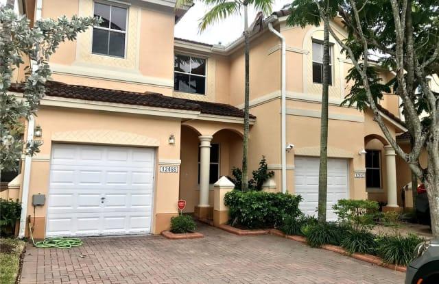 12488 SW 125th Ter - 12488 SW 125th Terrace, Three Lakes, FL 33186