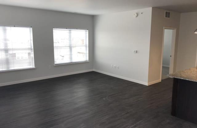 Metro Place Apartments - 301 West Lenawee Street, Lansing, MI 48933