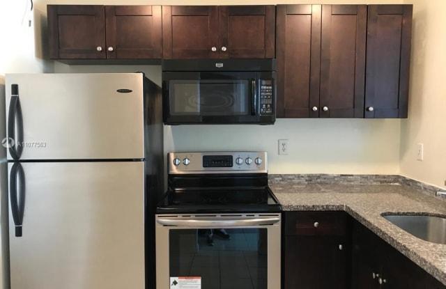 498 NW 165th St Rd - 498 Northwest 165th Street, Golden Glades, FL 33169