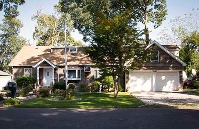 105 Huguenot Drive - 105 Huguenot Drive, Mastic Beach, NY 11951