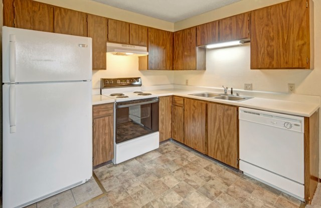 Brighton Woods Apartment Homes - 1204 Norman St, Anchorage, AK 99504