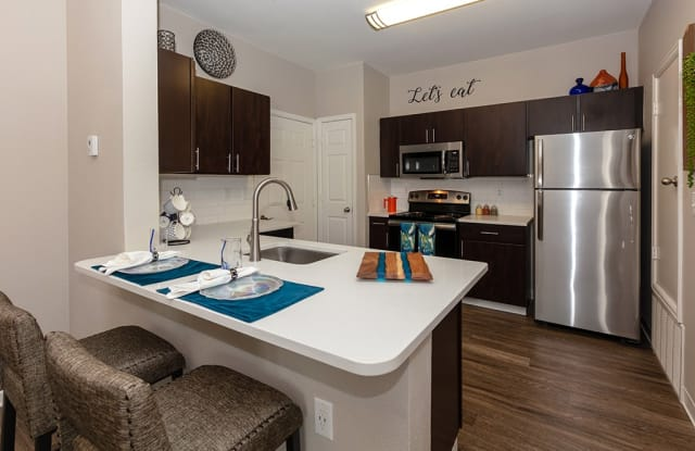 Windsor Townhomes and Apartments - 8153 W Eastman Pl, Lakewood, CO 80227