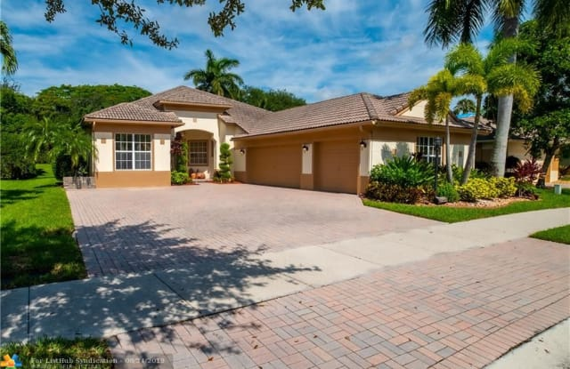 7069 NW 113th Ave - 7069 Northwest 113th Avenue, Parkland, FL 33076