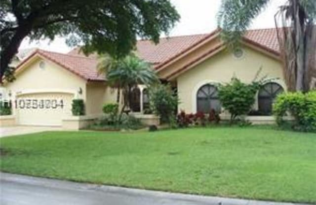 5975 NW 47th - 5975 Northwest 47th Place, Coral Springs, FL 33067