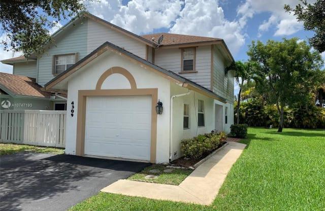 4309 NW 120th Ln - 4309 Northwest 120th Lane, Sunrise, FL 33323