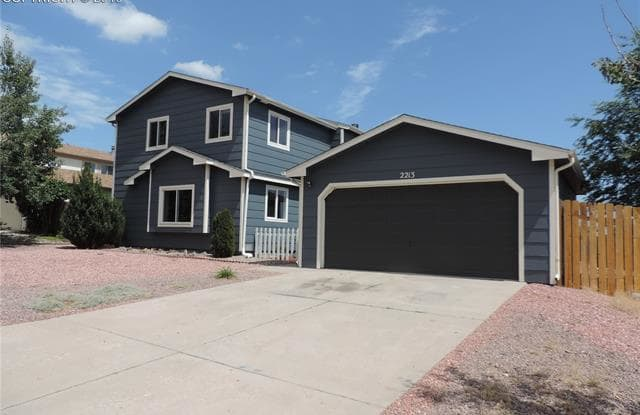 2213 Moccassin Drive - 2213 Moccassin Drive, Cimarron Hills, CO 80915