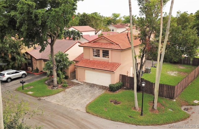 6332 NW 180th Ter - 6332 Northwest 180th Terrace, Country Club, FL 33015