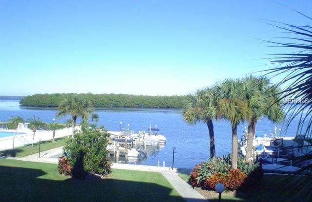 605 SUTTON PLACE - 605 Sutton Place, Longboat Key, FL 34228