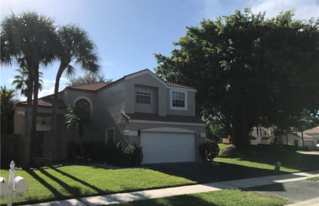 7701 NW 61st Ter - 7701 Northwest 61st Terrace, Parkland, FL 33067