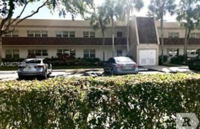 3700 Oaks Clubhouse Dr - 3700 Oaks Clubhouse Drive, Pompano Beach, FL 33069