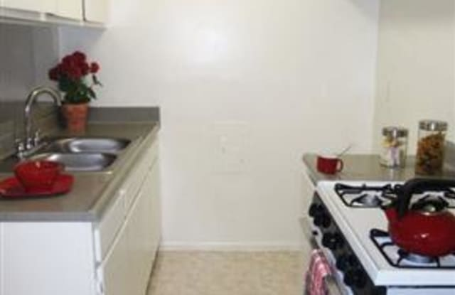 The Madrid Apartments - 7125 Lennox Ave, Los Angeles, CA 91405