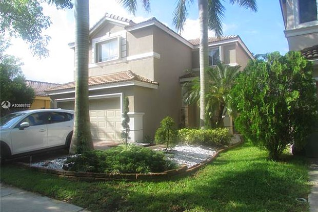1064 Golden Cane Dr - 1064 Golden Cane Drive, Weston, FL 33327