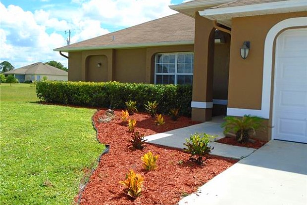 326 NE 27th TER - 326 Northeast 27th Terrace, Cape Coral, FL 33909
