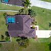 1219 Rose Garden RD - 1219 Rose Garden Road, Cape Coral, FL 33914