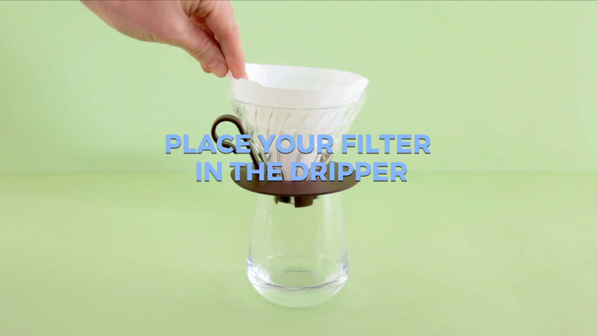 Place your filter inside the dripper and rinse with the freshly boiled water