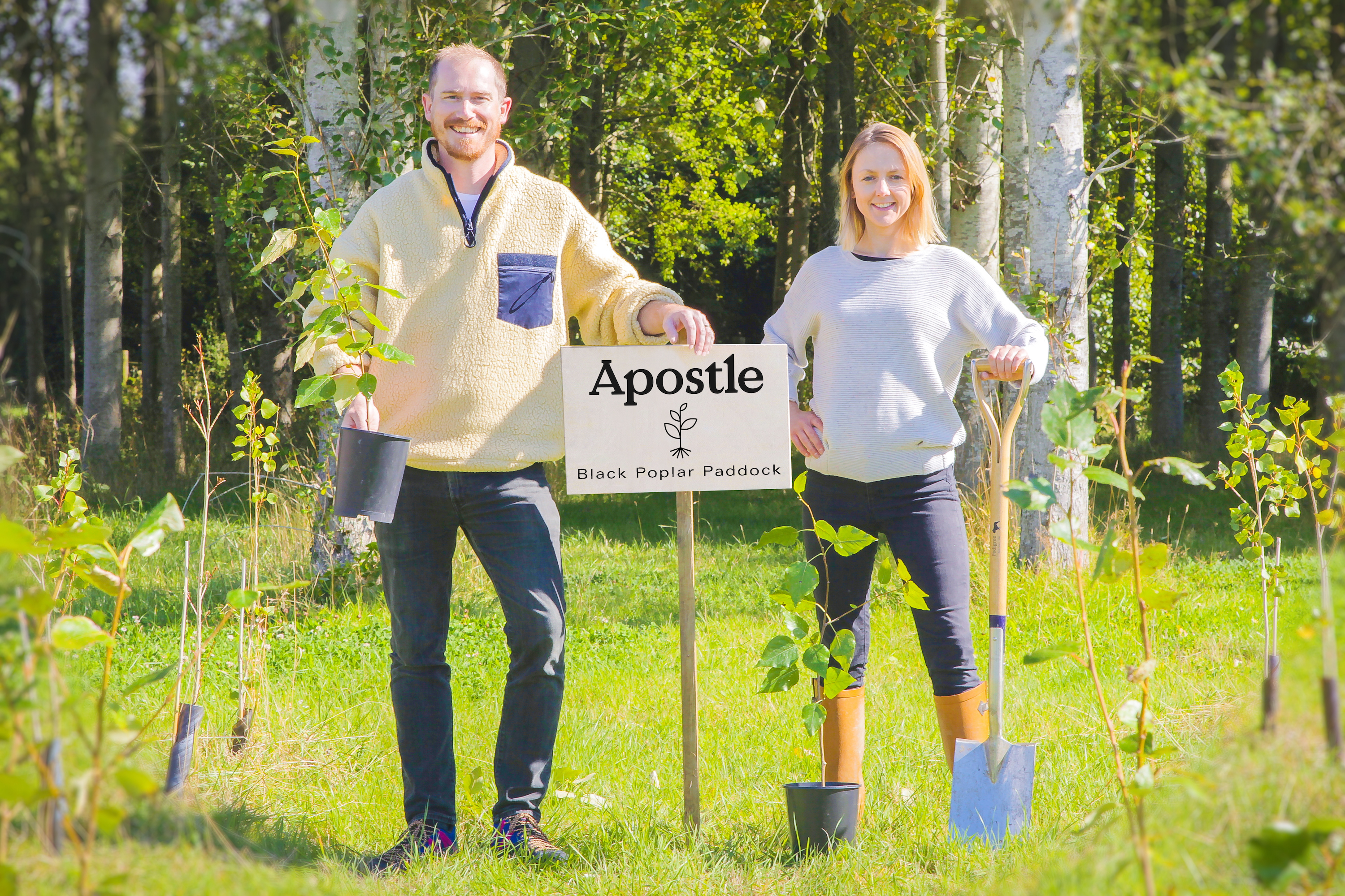 the apostle coffee team standing in a wood