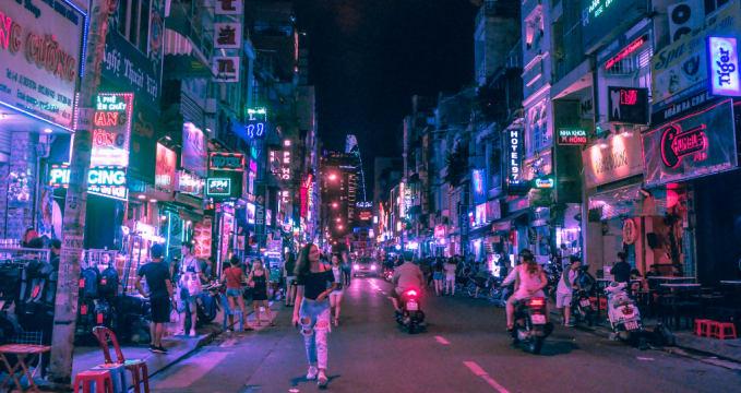 Bui Vien Walking Street - https://www.wallpaperflare.com/bui-vien-walking-street-woman-walking-in-the-middle-of-the-road-during-nighttime-wallpaper-zpank