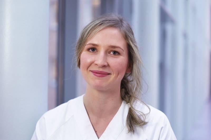Portrett av en smilende helsearbeider. Foto: Øivind Haug