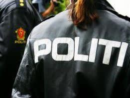 Politiet - logo på ryggen