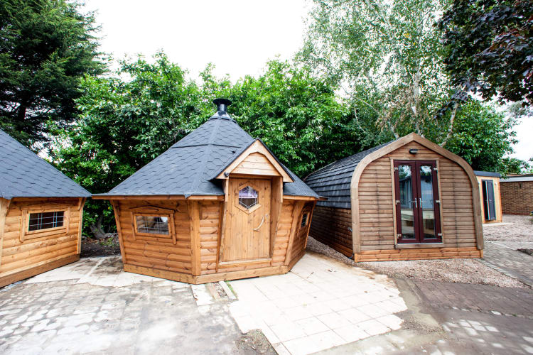 Two BBQ cabins sat beside a camping pod on our show site.