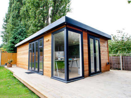 A studio building situated on decking.