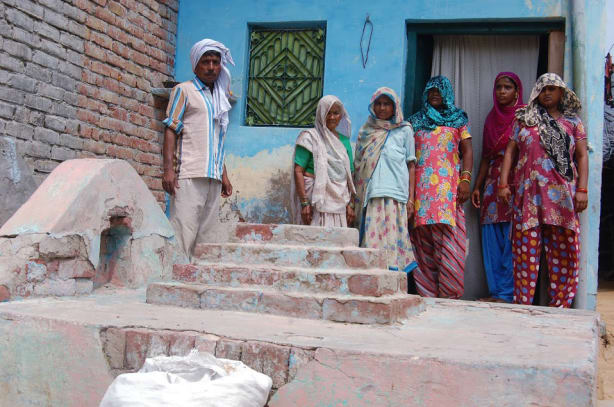 Muslim people standing in front of a grave inside their houe. Photo courtey 101reporters copy