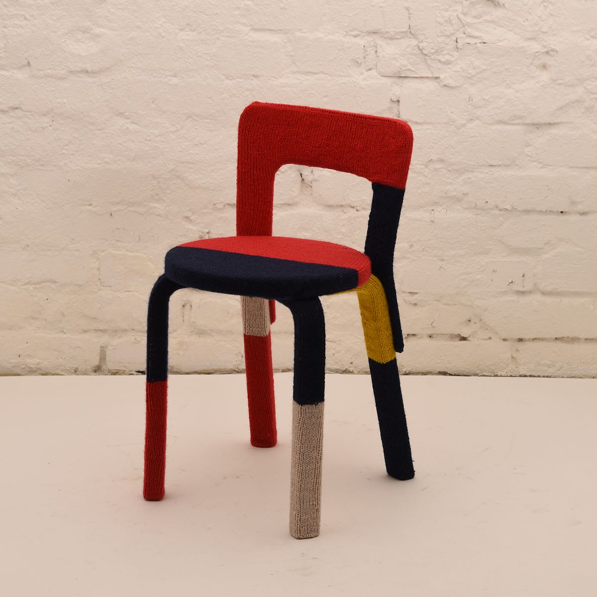 Alvar-Aalto-Eija-Zweygberg_Wool-Covered-65-Chair_A