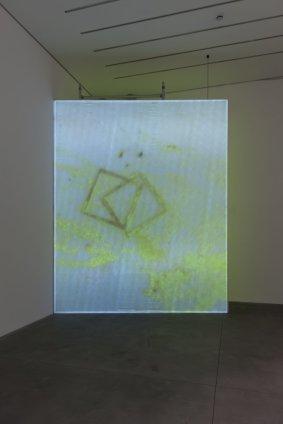 Ian Kiaer  Black tulip, yellow, film, 2012  lighting gel, taffeta, aluminium, projector, DVD  screen: 450 x 360 cm / 177 1/8 x 141 3/4 ins