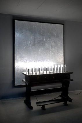Thomas Zipp  PARTIALISTIC CHAPEL, 2012  Aluminium on flesh colour painted canvas (mushroom shaped grinder), table and electrical candles  Painting: 200 x 170 cm, 78 3/4 x 66 7/8 ins Sculpture: 133 x 55 x 103 cm, 52 2/8 x 21 5/8 x 40 4/8 ins