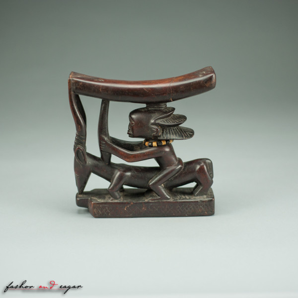Prestige Headrest: Figure Riding an Antelope