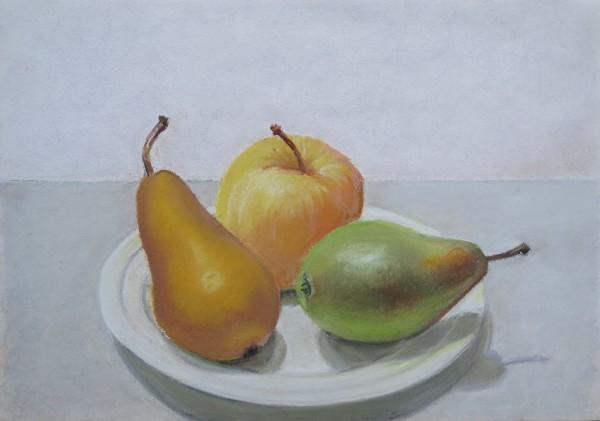 Trois fruits sur une assiette