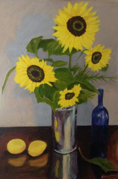 Sunflowers, lemon, blue bottle