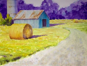 Turquoise barn and haybales
