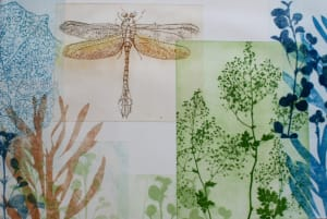 Golden dragonfly with large blue leaf
