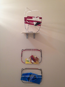 Intuitive Trainings: wall installation with standing shelf piece and two wall hangings