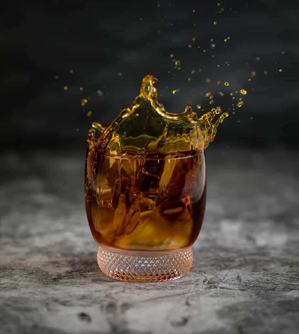 Rum splashing out of a glass
