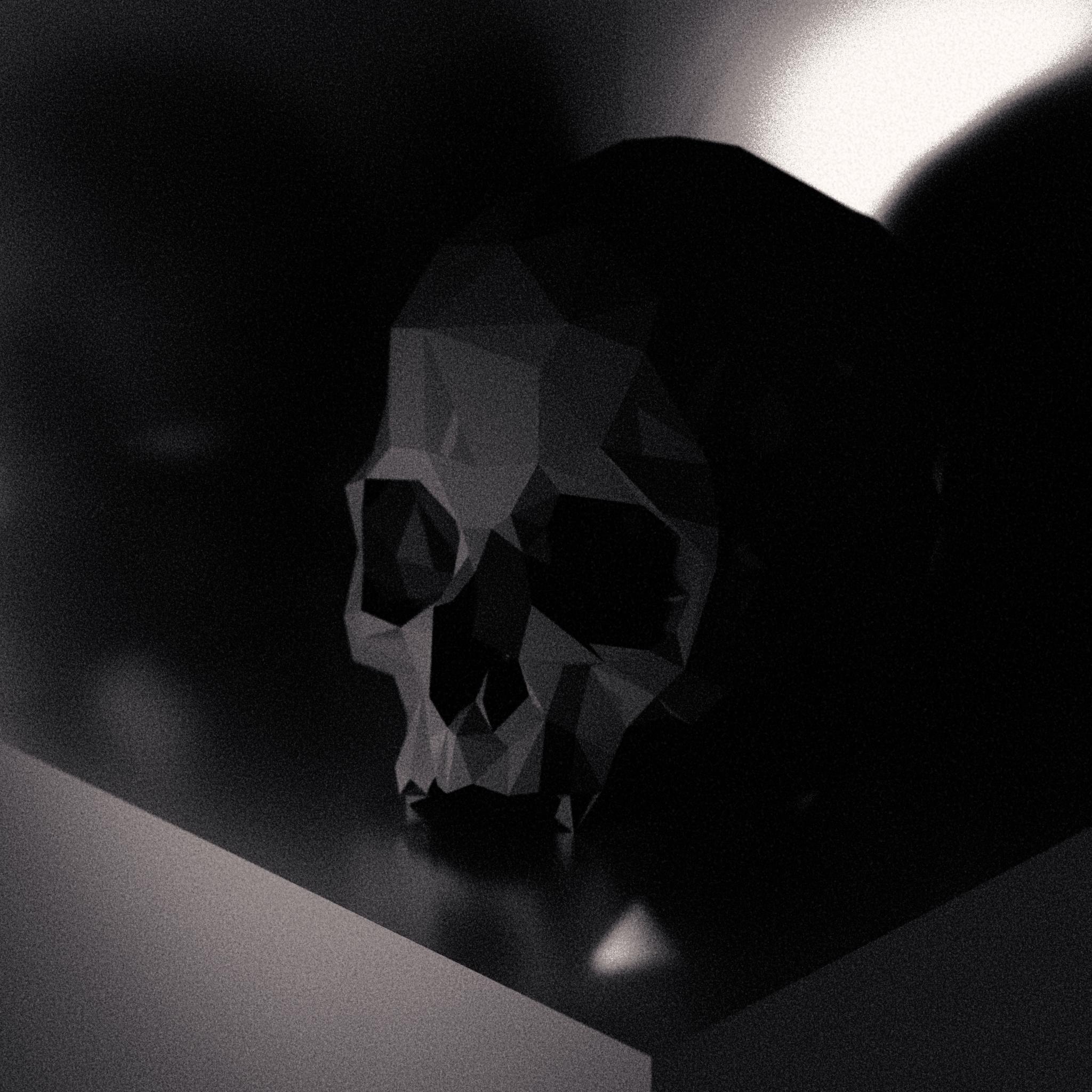 Skull on metal plinth