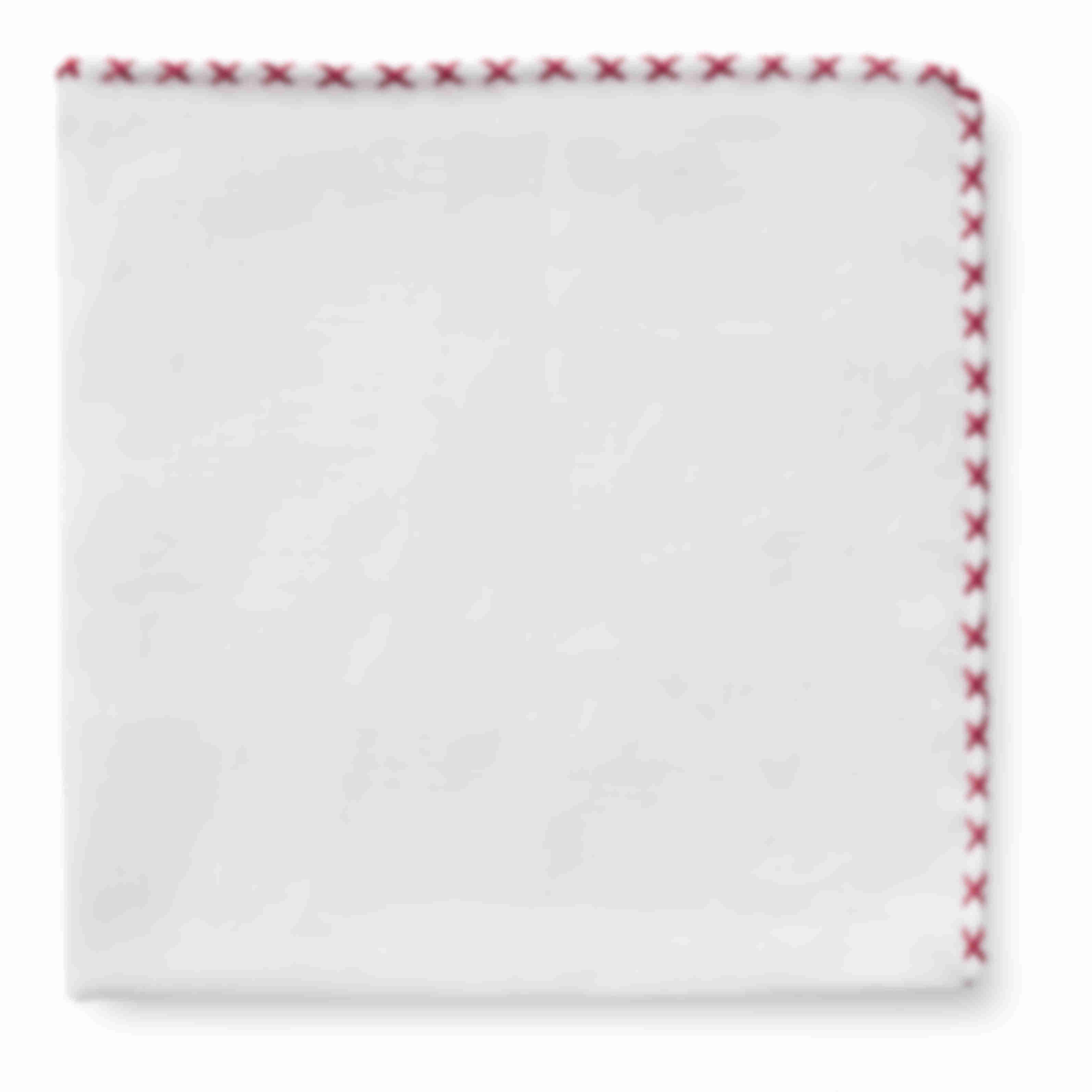 Pochette blanche surpiqûre main rouge Atelier Mesure