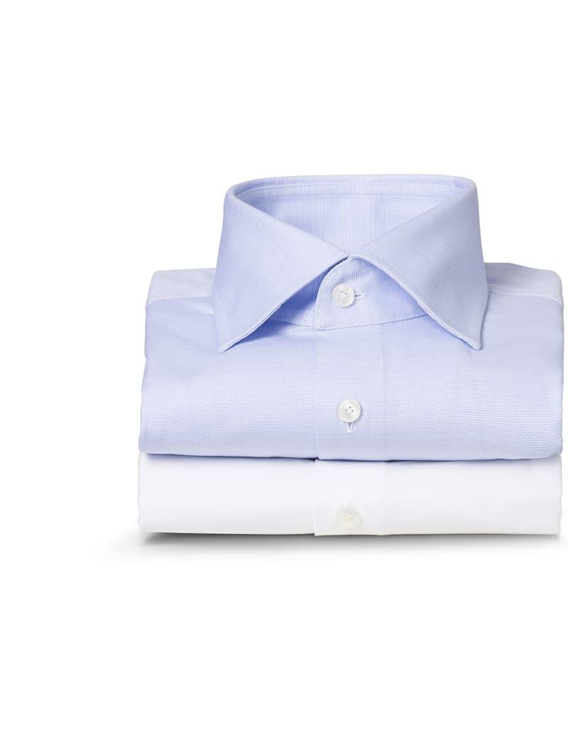 Pile de deux chemises business, blanche et bleue, sur mesure Atelier Mesure