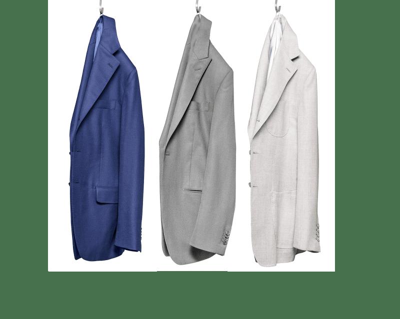 Vestes déconstruites sur mesure suspendues bleu gris et crème Atelier Mesure