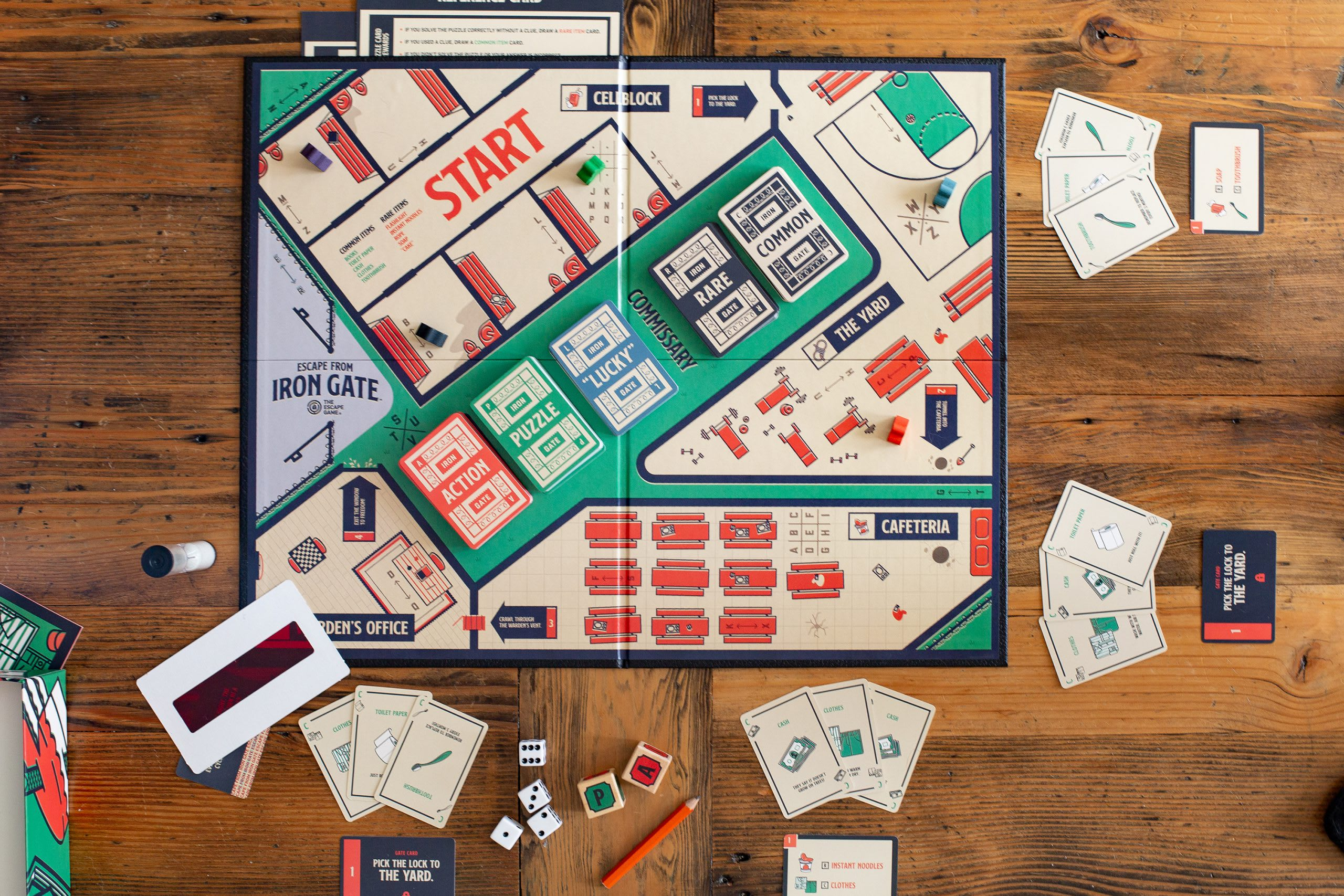 An escape room themed board game sits ready to play on a table. The board is offered online from The Escape Game Atlanta.