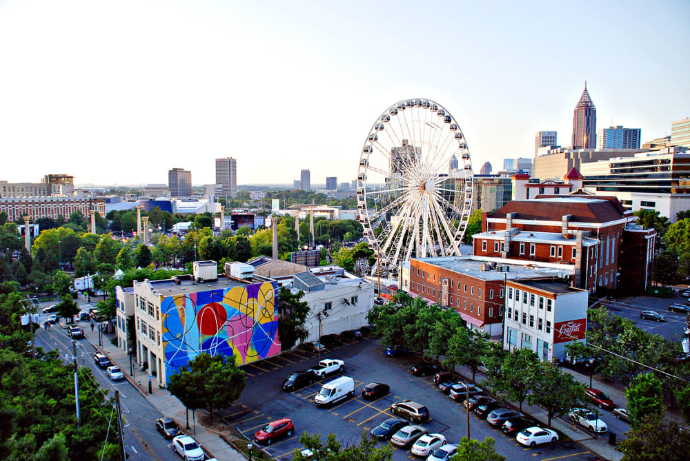 An aerial view of SkyView Atlanta, facing Centennial Olympic Park, from a nearby parking deck.