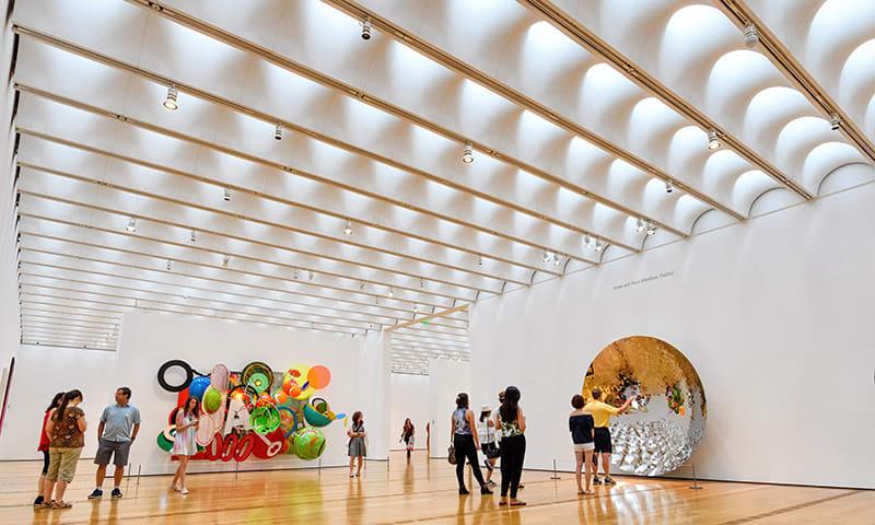 Guests look at an exhibit at the High Museum of Art in Atlanta, Georgia.