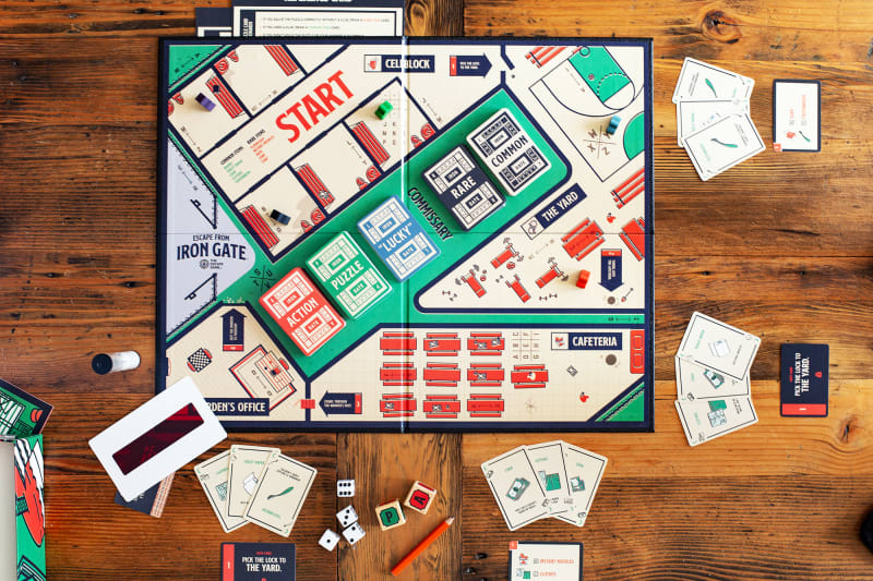 A tabletop view of an escape room board game that you can play at home, by The Escape Game Atlanta.