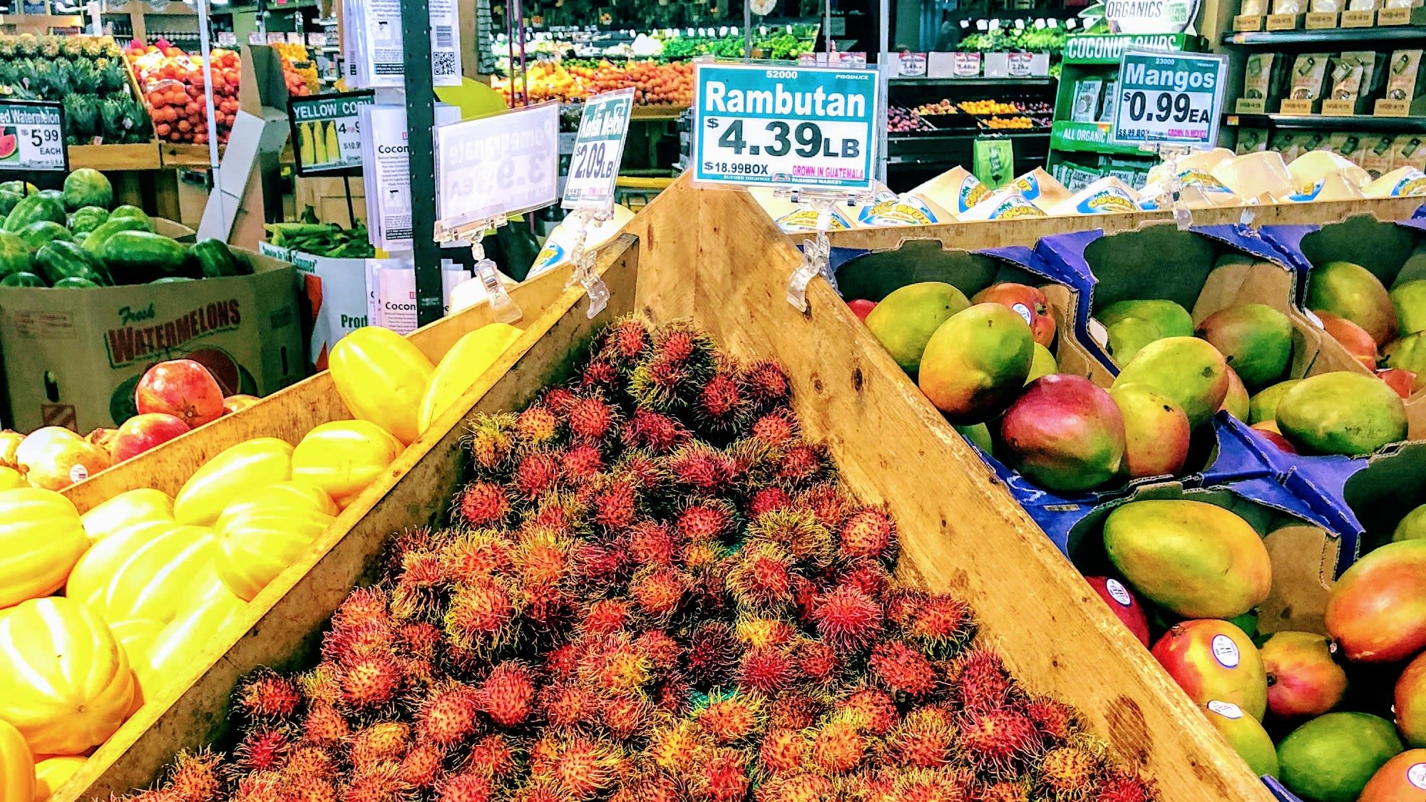 Display of colorful fruits -- rambutan, mango and watermelon -- at Buford Highway Farmers Market