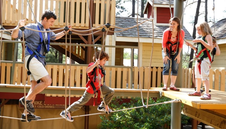 Family does high ropes course, Skyhike, at Stone Mountain