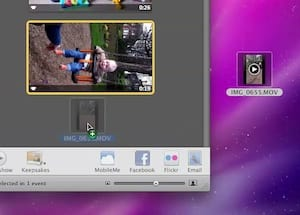 Drag the video file from from the desktop back into iPhoto