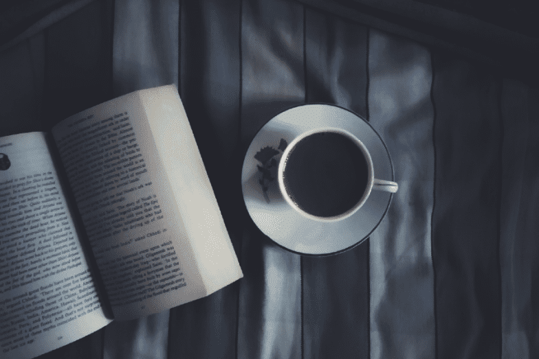 book and coffee in a dark room