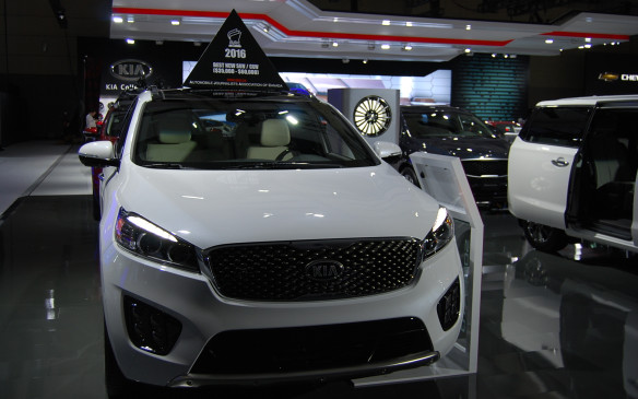 <p>The Automobile Journalists Association of Canada (AJAC) displays car toppers to identify its winners each year at the show. This 2016 Kia Sorento was voted Best New SUV/CUV ($35,000 - $60,000) but it was beaten out by the 2016 Mazda CX-3 for overall honours as Canadian Utility Vehicle of the Year.</p>