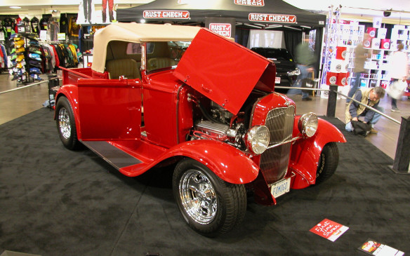 <p>Shawn Fairbairn's 1930 red Ford Model A roadster pickup is another classic hot rod, again created with an all-steel body. It does step away from the norm, however, by having a fully balanced Ford 302-cubic inch V-8 up front, rather than the small-block Chevy that's typically found in these hot rods. </p>
